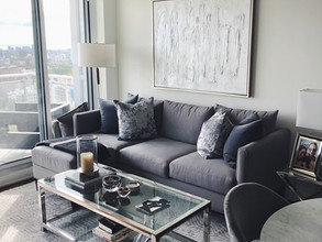 bright living room with grey sectional