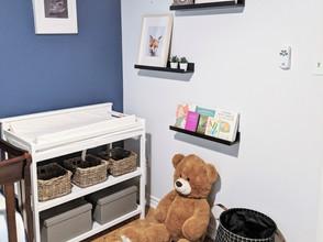 IKEA black fabric laundry basket beside changing table