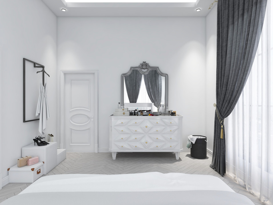 White dresser with gold pulls in a large bedroom