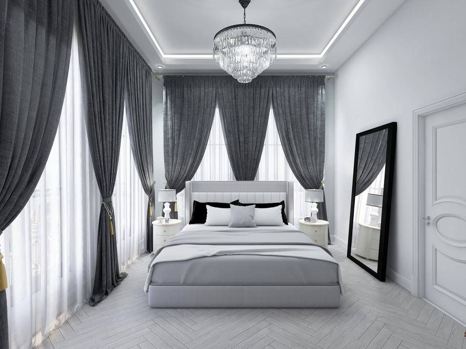 Modern and luxe master bedroom with ceiling to floor window treatments