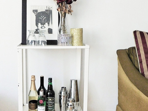 new york styled bar cart with fashion artwork and roses