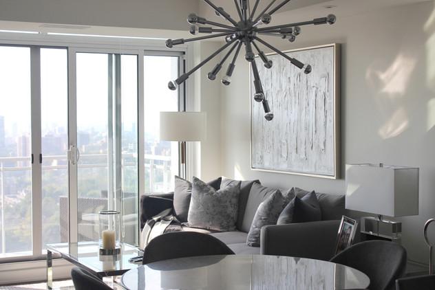 sputnik ceiling light over marble dining table