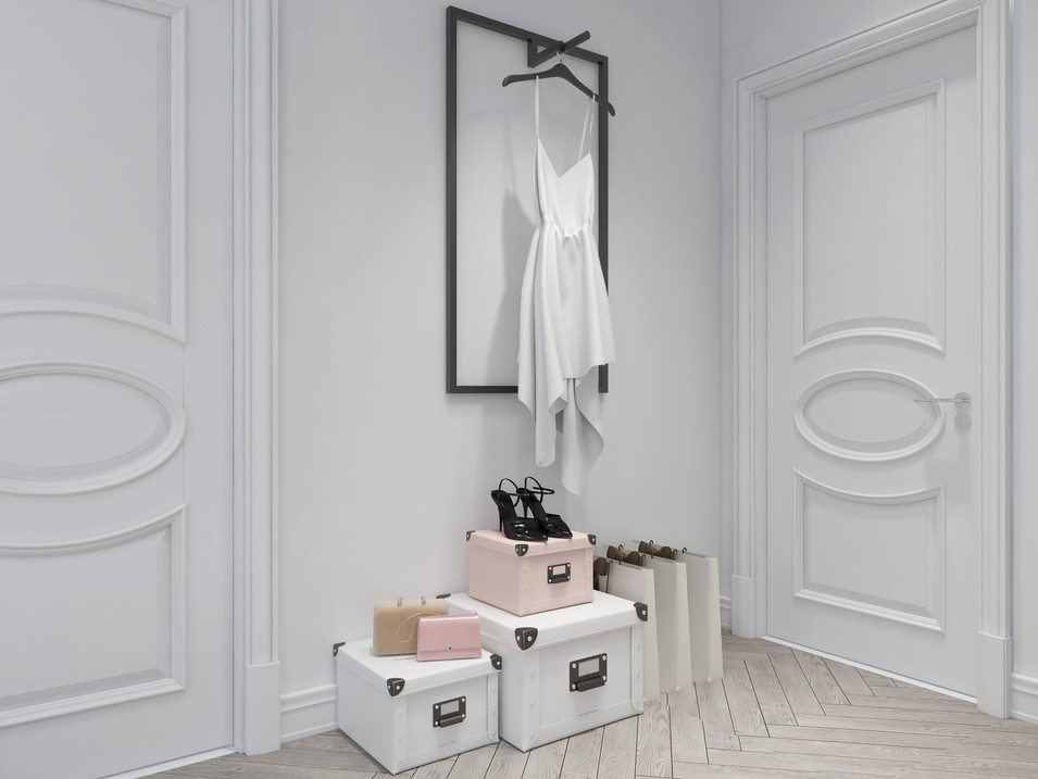 White dress hung adjacent to a wall in bedroom