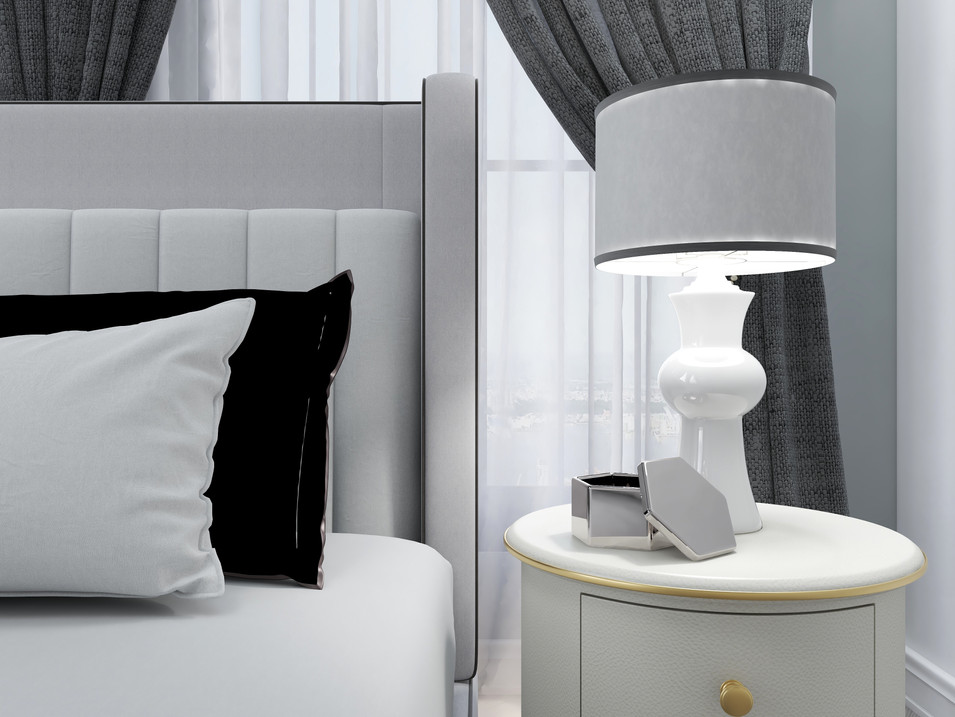 Round Nightstand beside a king size bed