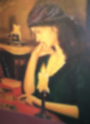 Gypsy psychic studying Tarot cards by candlelight