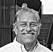 Julio Rovegno headshot BW for site.png