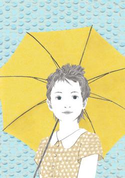 黄色い傘を持つ少女