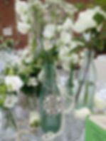 Wedding table center pieces with flowers and broaches