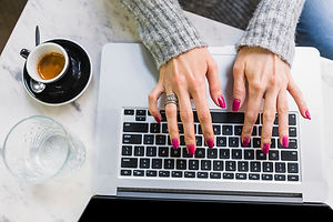 female-hands-typing-laptop_23-2147834487