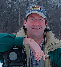 Steve Portrait with Camera.jpeg
