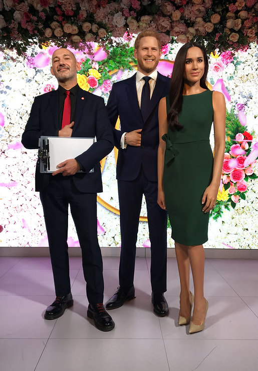 London entertainer next to Harry & Meghan waxworks at a corporate event at Mme Tussauds