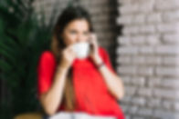 beautiful-woman-drinking-coffee_23-21479