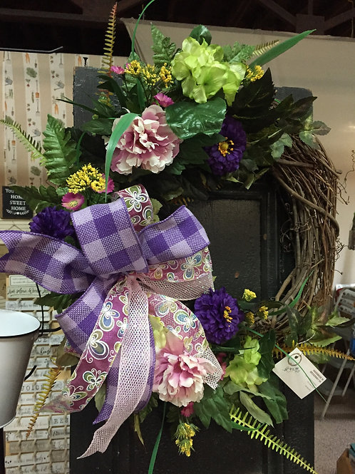 Grapevine Wreath with flowers and purple bow