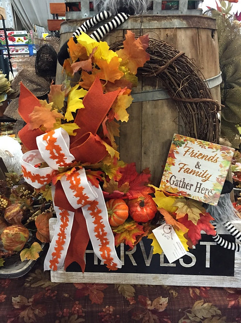 "Fall Grapevine wreath w/""friends + family"" sign"
