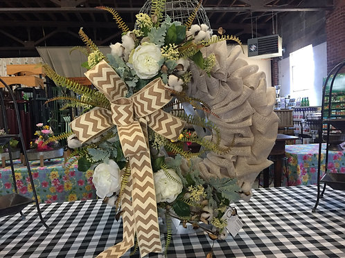 Burlap wreath with tan bow and flowers