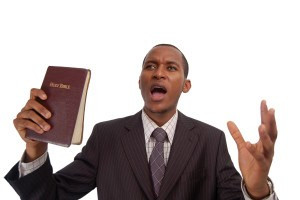 """this is an image of man holding a bible. this image can be used to represent """"sermon"""" """"preaching"""" etc..."""