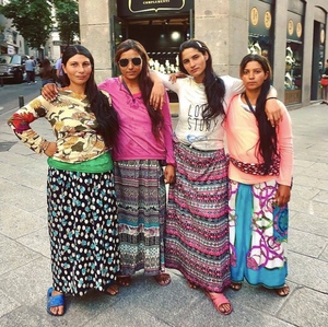 Four Romani girls dressed in bright clothes in Madrid