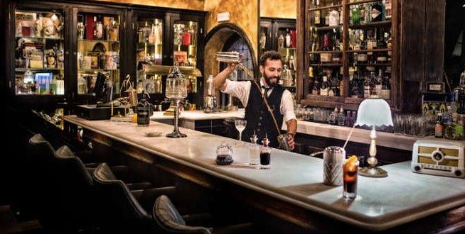 Pouring cocktails at Viva Madrid Taberna