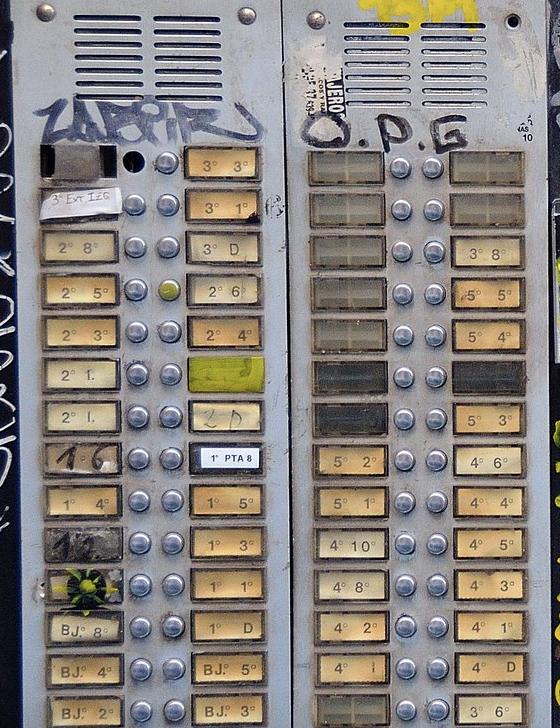 A bank of door buzzers