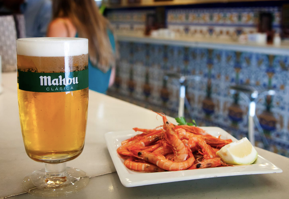 A ´doble´ of Mahou beer with a tapa of gambas
