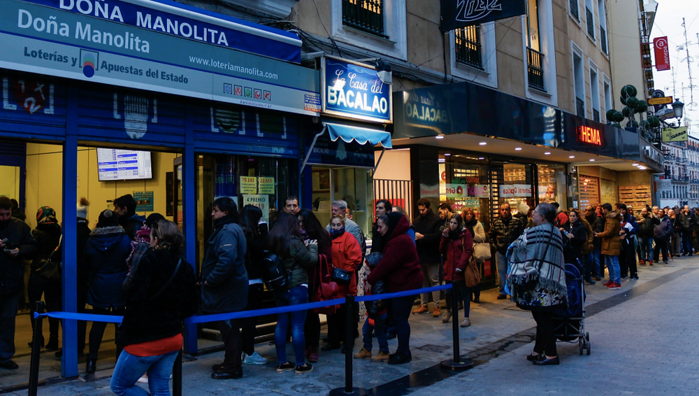 Hopeful people queuing to buy a Christmas Lottery ticket from Doña Manolita