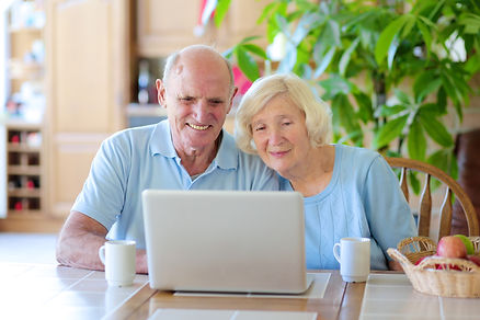 Two smiling people, active senior couple