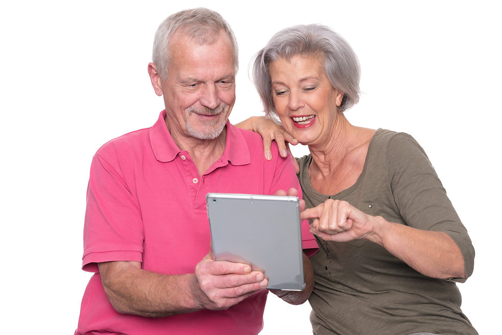 Senior couple with tablet computer in fr