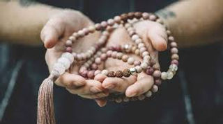 Mala Beads in Hand.jpg