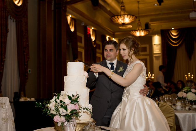 Tina & Bryce Wedding - cutting the cake.
