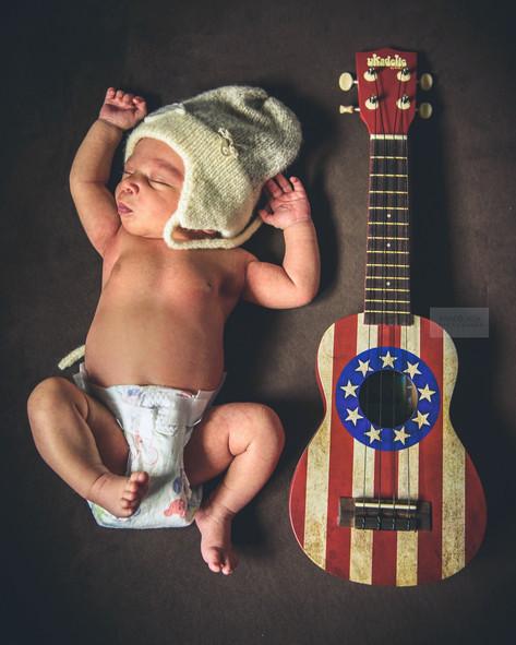 baby and ukulele