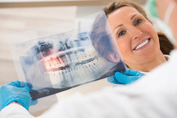 stockfresh_7140549_dentist-with-teeth-x-