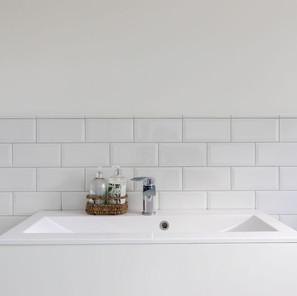 Modern classic bathroom in a period property