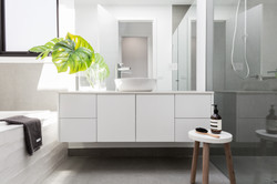 Luxury white family bathroom styled with