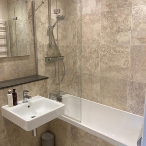 Wall mounted basin with shower over bath