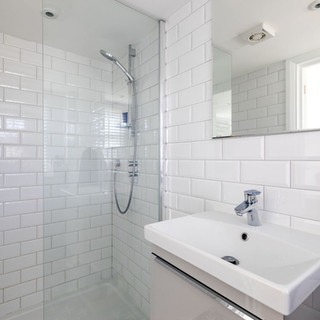 Shower room in a loft with reduced ceiling height