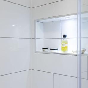 Recessed tiled shelf