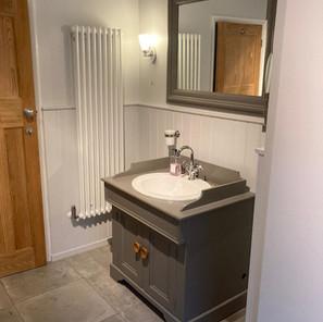 Traditional vanity basin in vintage washstand