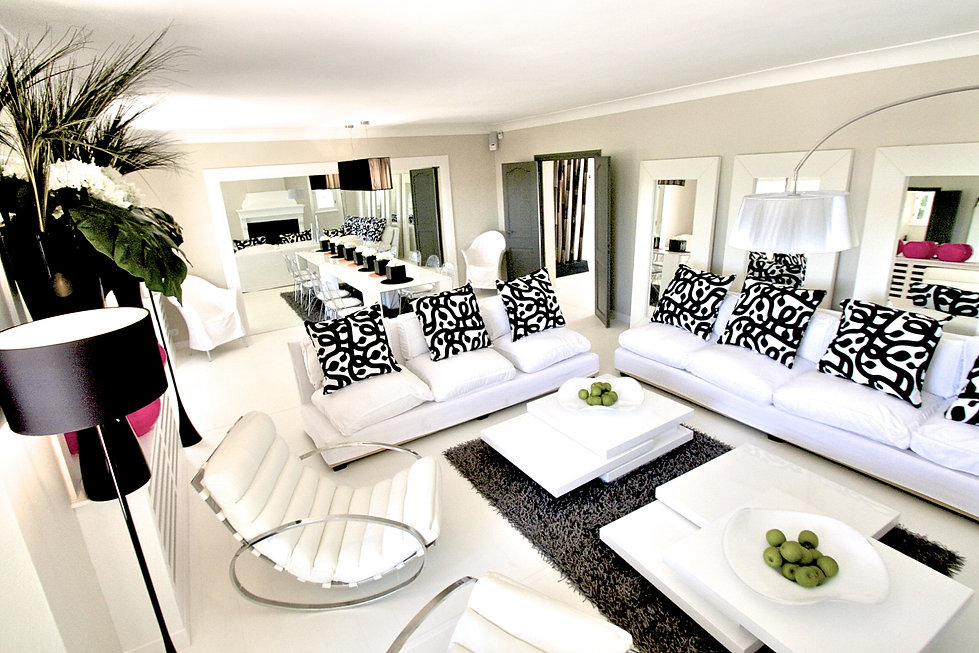 St Tropez Villa France living room sitting room lounge black and white modern eclectic layers coffee tables accents arc floor lamp open plan