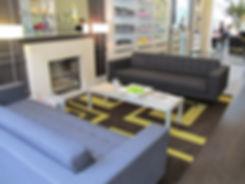 Charles Worthington Salon Fitzrovia lounge waiting area product display fireplace