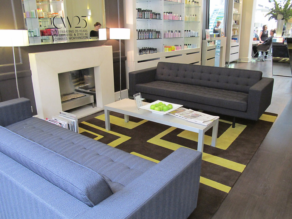 Charles Worthington Salon Fitzrovia lounge waiting area product display fireplace