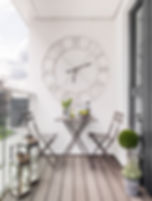 Shoreditch apartment balcony lanterns alfresco dining large wall clock