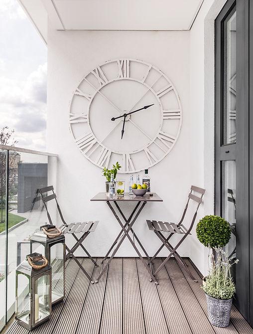 Shoreditch apartment balcony lanterns alfresco dining large wall clock