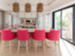 Private Residence St Barth's Kitchen island bar pink glass inset details pendant lights woven rattan