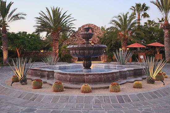 Resort Hotel Mexico exterior fountain palm trees uplighting umbrellas