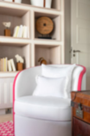 Private Residence St Barth's white tub chair an shelving