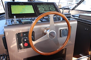 Private Yacht interior design luxury ship's wheel console