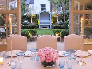 London Townhouse dining seating sunset roses tablescape candles
