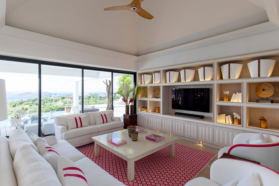 Private Residence St Barth's Drawing Room pink accents leather buckets bepoke joinery Big Ass Fan