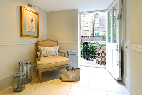 Chelsea Townhouse entry chair Chanel lanterns