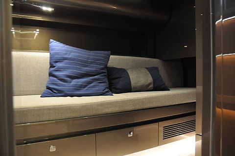Private Yacht interior design luxury storage convertable couch lounge blue pillows